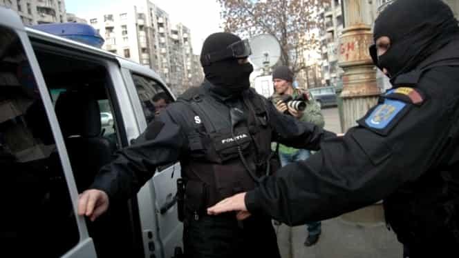 Percheziţii în Bucureşti şi în alte patru judeţe la suspecţi de evaziune fiscală şi spălare de bani