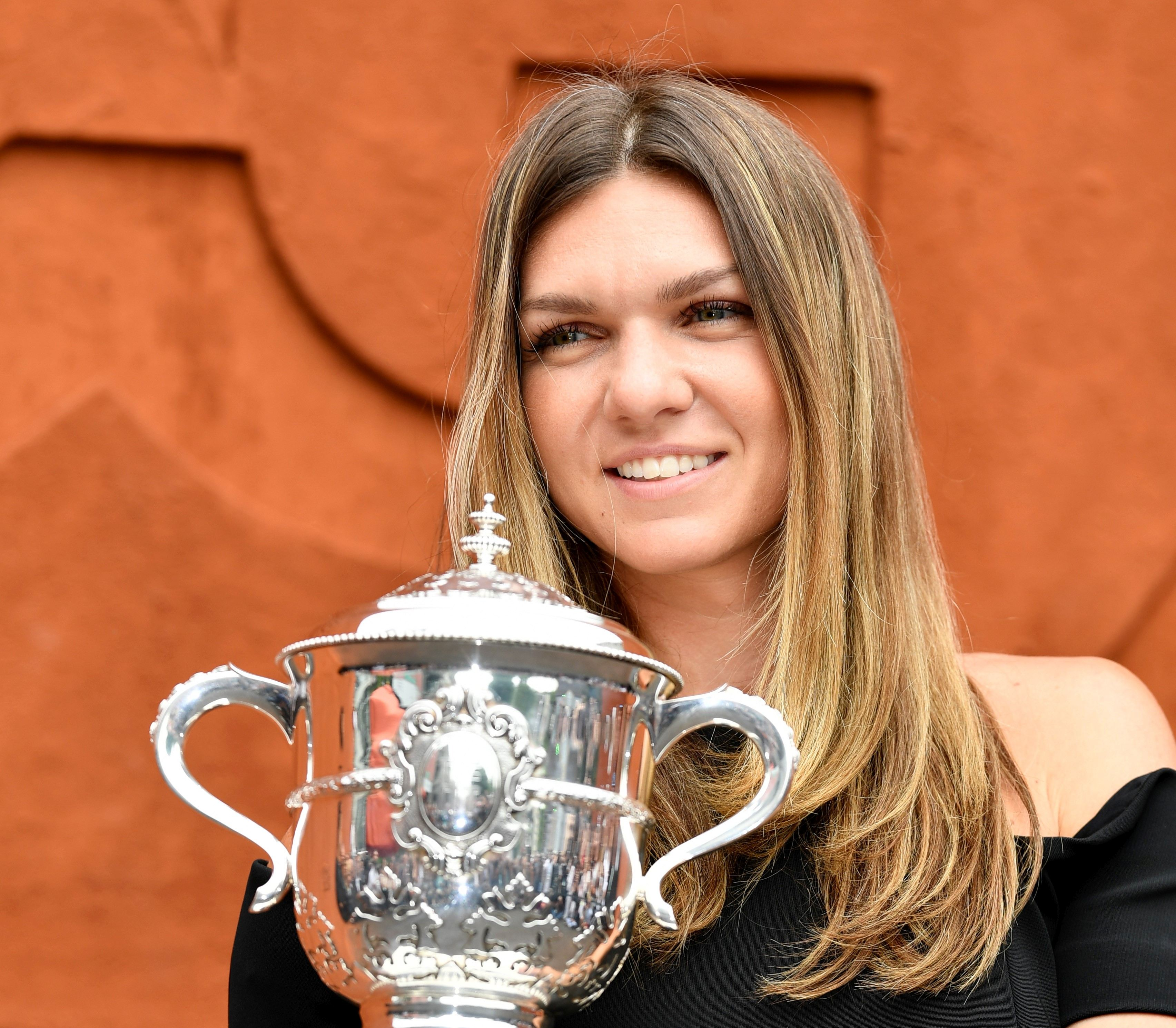 PARIS, FRANCE - JUNE 10: Simona Halep of Romania poses with championship trophy after winning her French Open finals match against Sloane Stephens (not seen) of the USA at Roland Garros Stadium in Paris, France on June 10, 2018. Mustafa Yalcin / Anadolu Agency