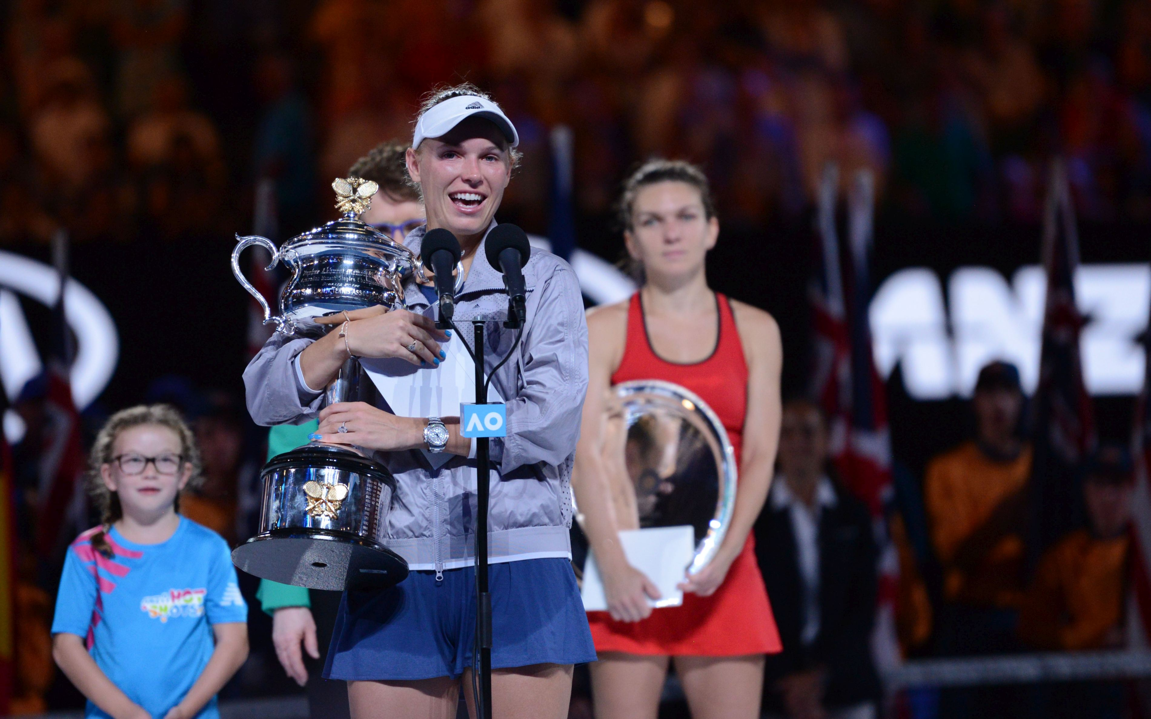 MELBOURNE, AUSTRALIA - JANUARY 27: Caroline Wozniacki of Denmark speaks after winning the women's singles final against Simona Halep (rear) of Romania on day 13 of the 2018 Australian Open at Melbourne Park in Melbourne, Australia on January 27, 2018. Caroline Wozniacki won the match with 2-1. Recep Sakar / Anadolu Agency