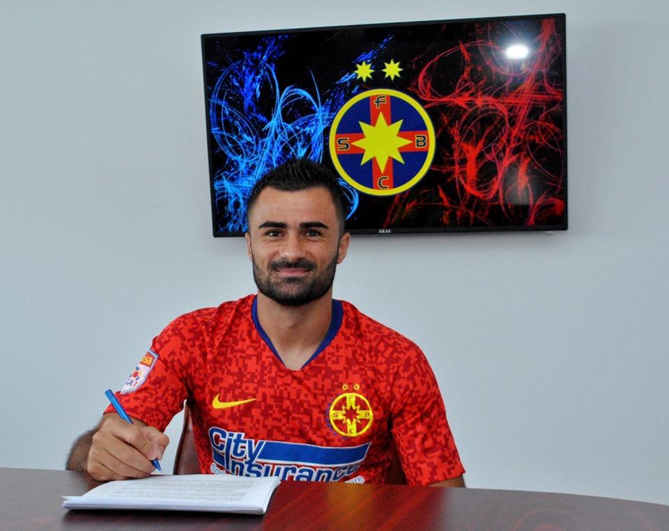 Momentul în care Valentin Crețu semnează contractul cu FCSB