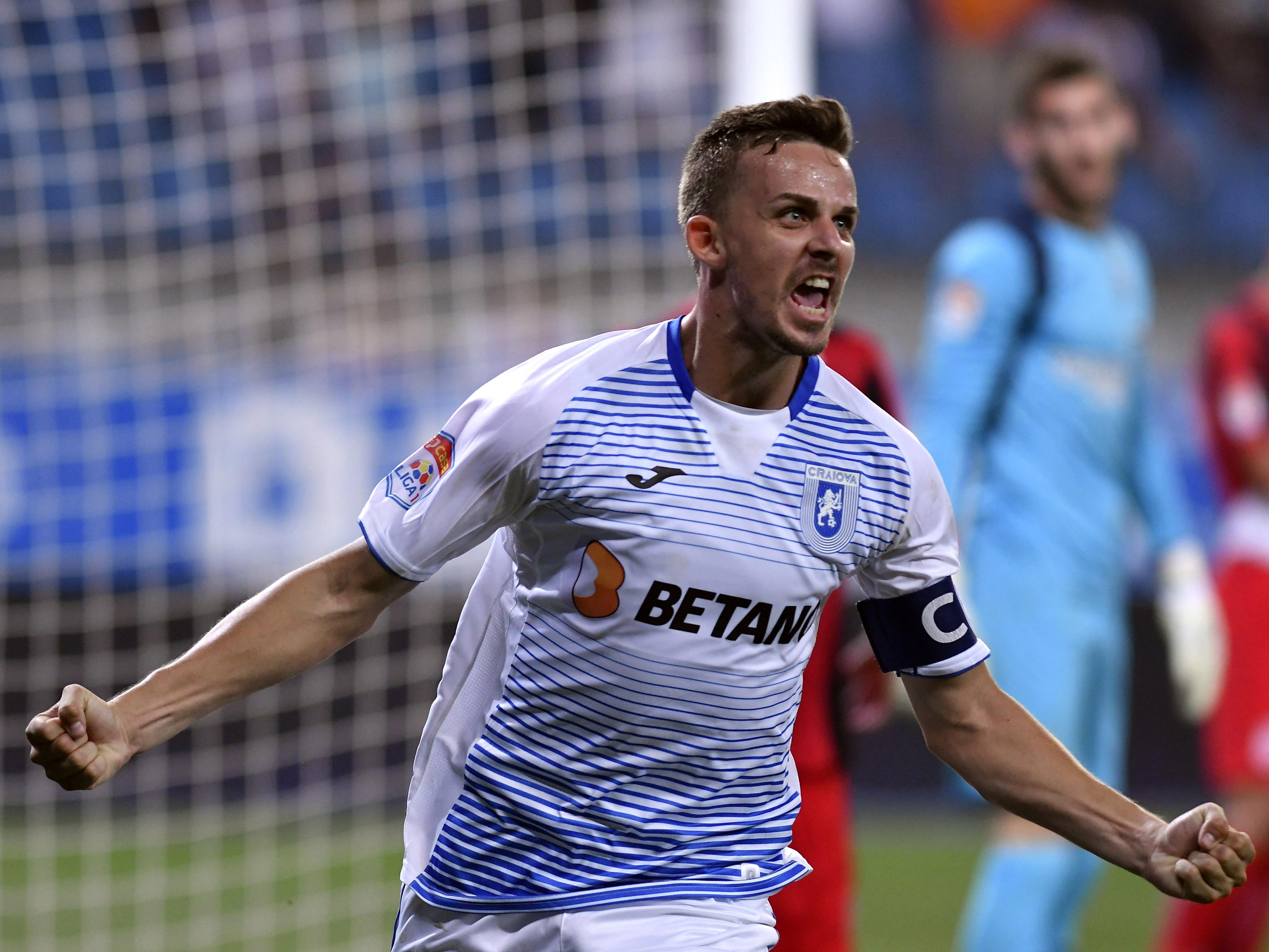 Nicușor Bancu se bucură după un gol înscris în meciul Universitatea Craiova - Astra. Sursă foto: sportpictures.eu