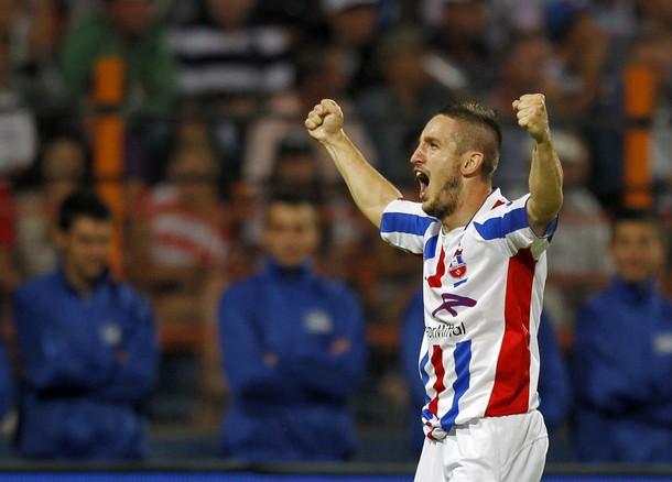 Otelul Galati's Bus celebrates after scoring against Steaua Bucharest during Romania's Super Cup soccer match in Piatra Neamt
